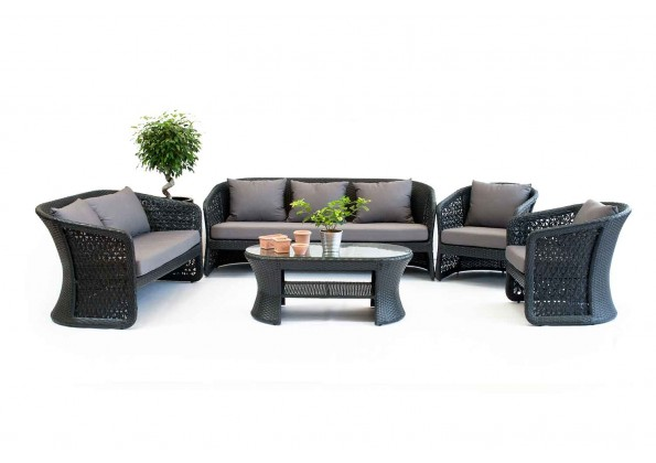 A Large Rattan Kit With Comfortable Cushions