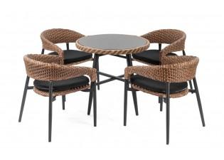 طاولة طعام دائرية بسطح زجاجي و كراسي لأربعة اشخاص مع وسائد