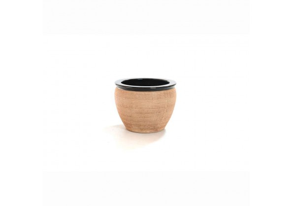 Pot With A Light Brown Color And Black Edges