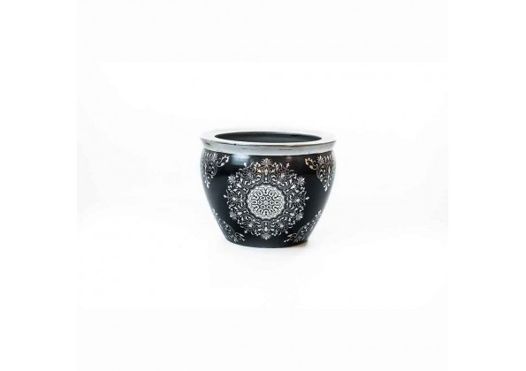 A Black Planter With Silver Carvings And Edges