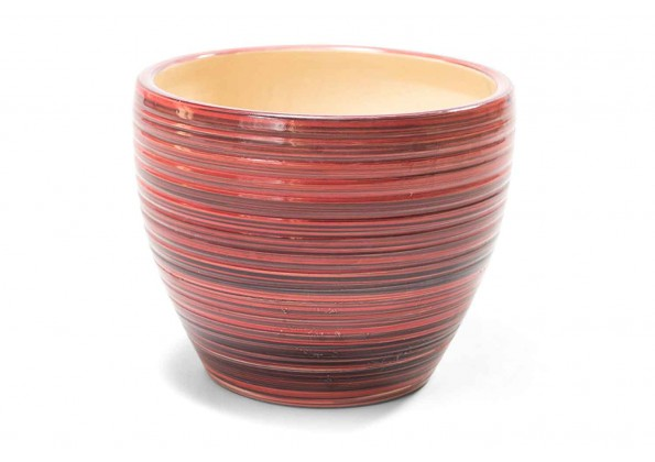 A Circular Planter With Shades Of Red Color