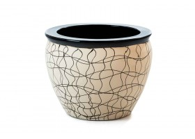 A Beige Pot Decorated With Drawings
