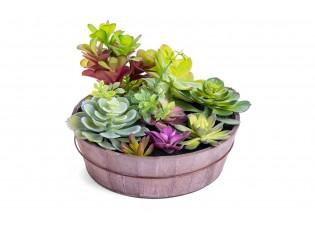 نباتات صناعية مع مركن دائري خشبي